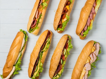 Fresh sub sandwich on white and wheat hoagies. Foto de archivo
