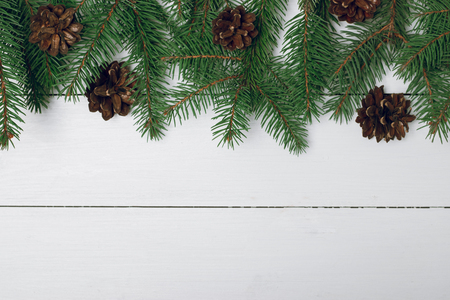 Christmas composition on a white background. Gifts, branches of fir and cones.