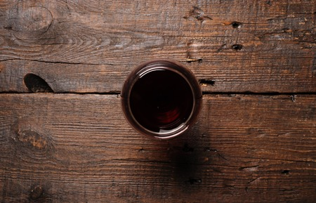 Glass of red wine on wooden table. View from top Stock fotó