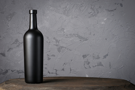 Red wine bottle on a wooden background 写真素材