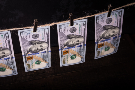 Money Laundering. Money Laundering US dollars hung out to dry. 100 dollar bills hanging on clotheslines 写真素材