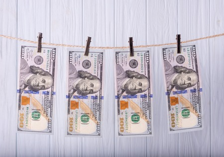 Money Laundering. Money Laundering US dollars hung out to dry. 100 dollar bills hanging on clotheslines Фото со стока