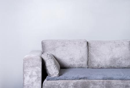 Comfortable sofa on grey wall background 写真素材