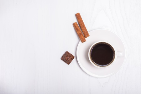Coffee cup top view on wooden white table background