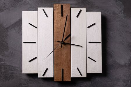 wall wooden clock at gray background texture