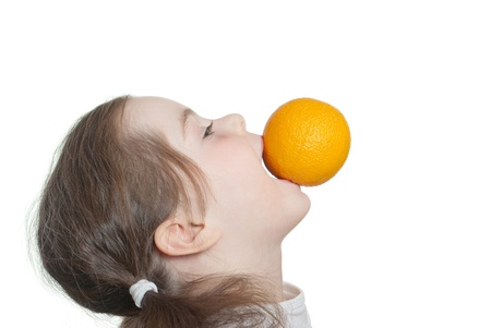 minx: Child with orange in a mouth