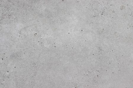 Concrete gray texture with small cracks