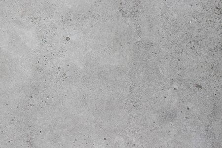 Concrete texture with small dots and cracks