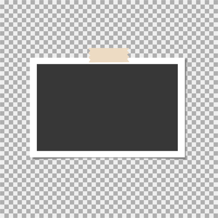 Black and white photo frame with sticky tape on a checked background.