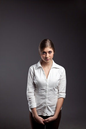 An image of a young girl in a white blouse photo