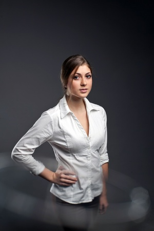 An image of a beautiful girl in a white blouse photo