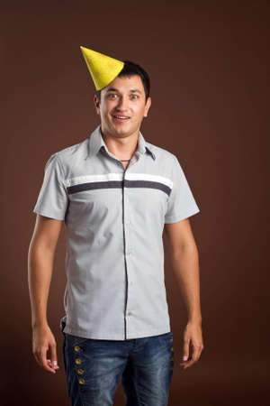 fellow: An image of a young fellow in a yellow cap Stock Photo