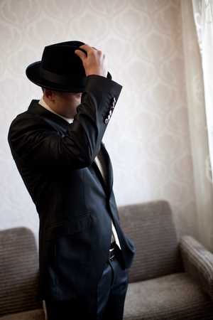 fedora: An image of a handsome man in a black hat Stock Photo