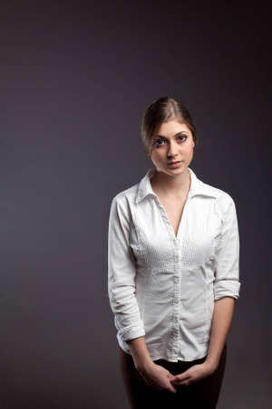 An image of a beautiful young girl in a white blouse photo