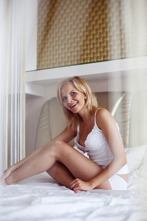 An image of a happy woman in bed Stock Photo - 13069478