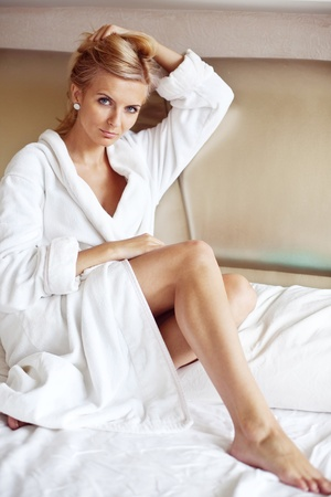 robes: An image of a young pretty woman in a white bathrobe