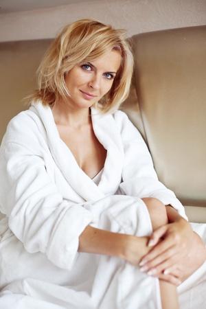 bathrobe: An image of a pretty woman in a white bathrobe
