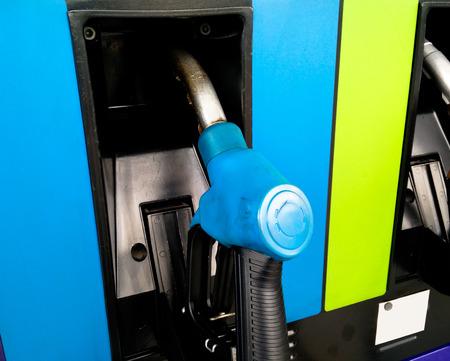 opec: Gasoline pump nozzles at petrol station