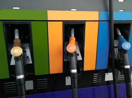 gasoline pump: Gasoline pump nozzles at petrol station