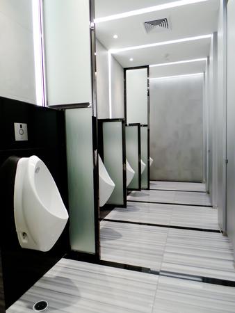 latrine: Urinals in the mens bathroom
