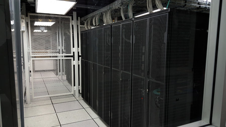 datacentre: room with rows of server hardware in the data center Stock Photo