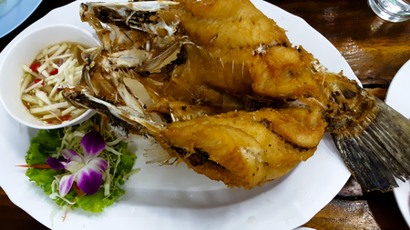 Fried fish on wood table Stock Photo
