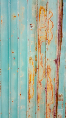 Old green rusty and dirty galvanized fence sheet background