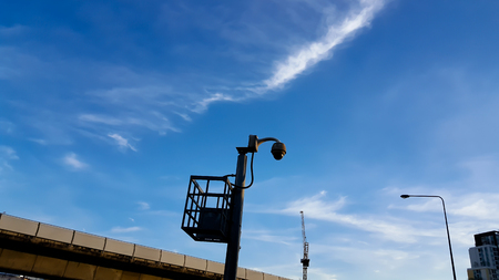 CCTV camera or surveillance operaiting on blue sky