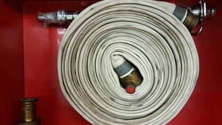 Fire hose equipment in a red metallic box Horizontal