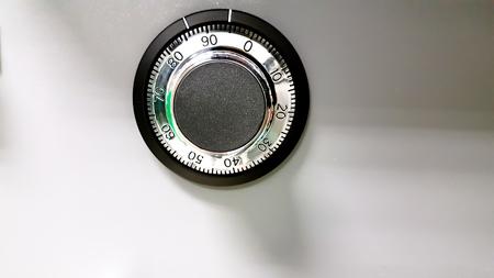 combination lock on the safe closeup gray Stock Photo