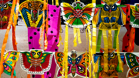 Recreation background different styles of animal kites hanging for sell Stock Photo