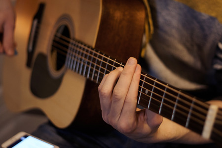 Guitarist holding a song on the guitar