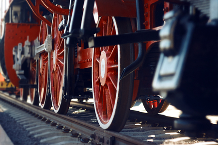 The red wheels of an old vintage steam locomotive, actively used in the 20th century, and now an exhibition model in the Museum. Imagens
