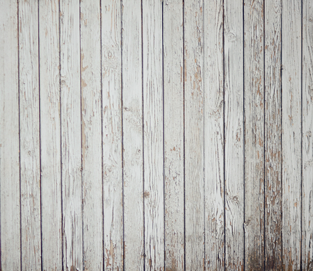 Abstract background of old painted white boards. From time, old age and dampness paint crumbles. Stock Photo