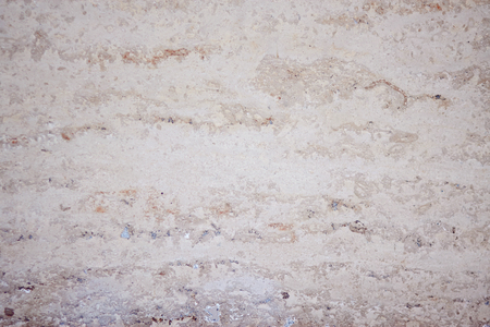 Abstract blank background with smooth wall surface made of white limestone tuff with places of other colors