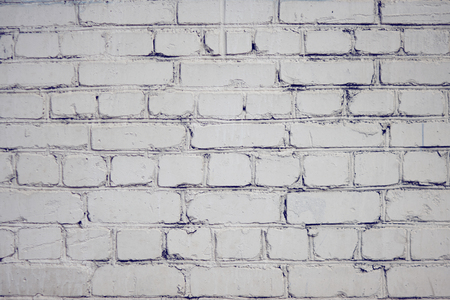 Blank abstract background with smooth brick surface, painted with white paint. Light layout for labels Фото со стока