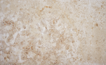 Abstract colorful smooth background from calcareous tufa beige hue with light inclusions