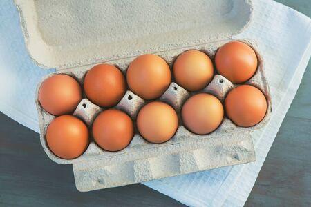 Fresh egg in a cardboard box