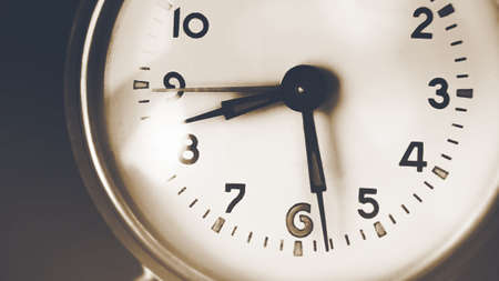 The old clock on the dial shows half-past eight in the morning. Fast-moving time and the past. Memories. Standard-Bild