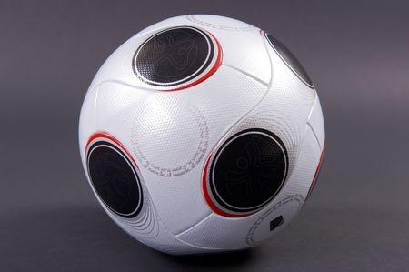 uefa: An official UEFA EURO2008 match soccer ball in white and black, on dark grey background - not isolated.