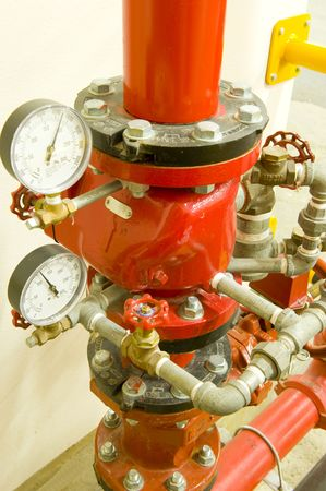 Industrial high pressure valve and taps for a fire extinguishing system. Pressure gauges are showing water pressure.
