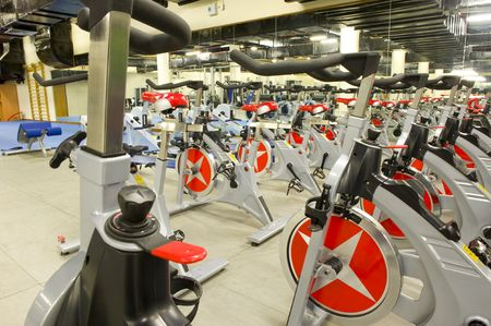 Gym or gymnasium equipment in a world-class facility suitable for athletes training for international events. Picture shows fitness cycles.