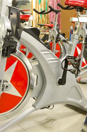 Gym or gymnasium equipment in a world-class facility suitable for athletes training for international events. Picture shows fitness cycles. Stock Photo - 3128283