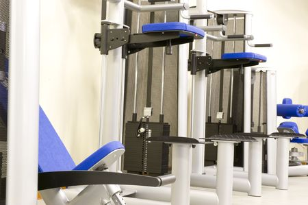 adjustable dumbbell: Gym or gymnasium equipment in a world-class facility suitable for athletes training for international events.