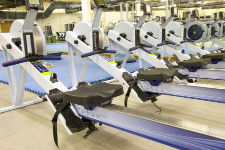 Gym or gymnasium equipment in a world-class facility suitable for athletes training for international events. Picture shows rowing machines.