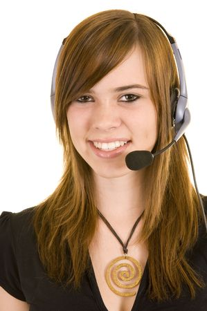 Beautiful young business lady wearing a headset for communications, isolated on a white background. photo