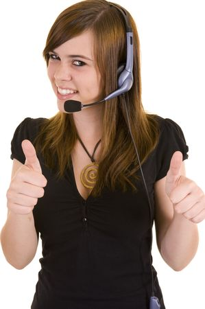 Beautiful young business lady wearing a headset for communications, isolated on a white background.
