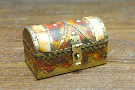 inlays: Beautiful renovated small antique jewelery box made of wood with copper and ivory inlays. Stock Photo