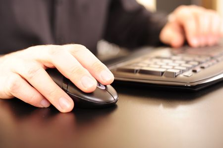 Caucasian male hands on a keyboard. Shallow DOF for abstract conceptual design effect or background. photo