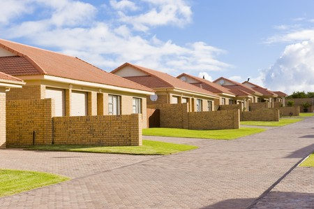 A typical suburban housing development showing a row of similar houses in a compound.